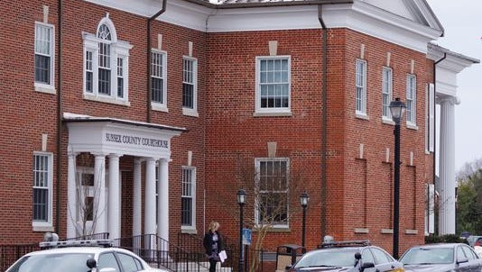 Vehicles are parked outside the Sussex County Courthouse in February. The Delaware Supreme Court has imposed a 30 day suspension on Deputy Attorney General Adam D. Gelof following a prank involving a firearm at the Sussex County Courthouse.