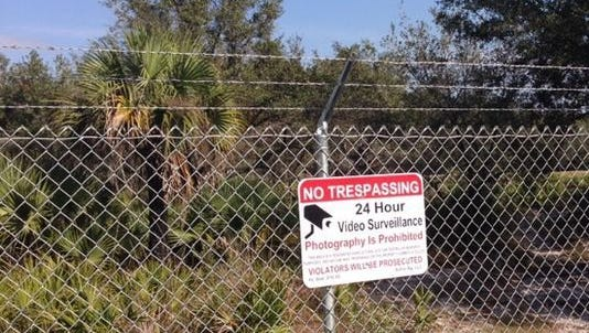 A sign on the perimeter of the would-be site of a controversial monkey farm on the Lee-Hendry county border.