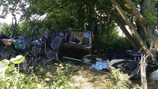 Firefighters used hydraulic tools to free the driver and passenger in this vehicle, which crashed into a tree while traveling east on I-96 near Coopersville on Monday, June 27, 2016.