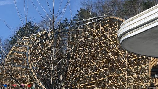 "Lightning Rod includes an overbanked turn for its finale. It features a ""Topper"" track, an innovation developed by its builder, Rocky Mountain Construction. RMC's patented track uses a thick metal coating that entirely covers the wood."