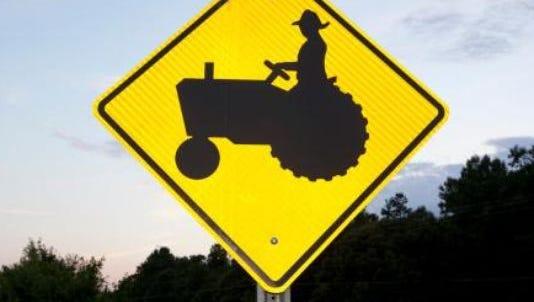 Tractor crossing logo.