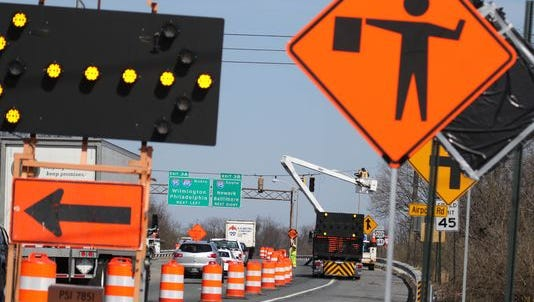 Road crews slow traffic at the northbound approach to the Del. 141, I-95 interchange.