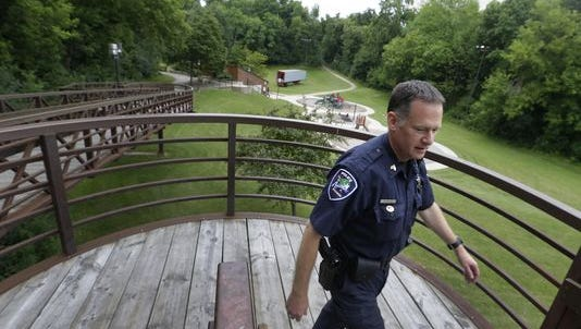 Sgt. John Berkley of the Appleton Police Department walks on patrol through Jones Park last year. Jones Park has been a trouble spot because of drinkers congregating there.