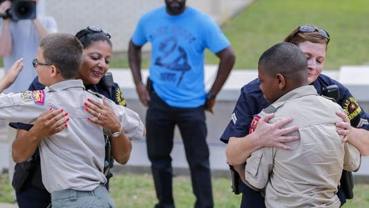 Boy Scouts hug Dallas police officers on July 10.