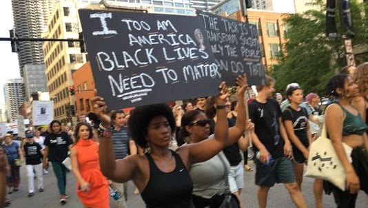 Melody Angel, 25, was among the hundreds of protesters that took to the streets of Chicago on July 11, 2016, for a demonstration called in response to last week's police shooting deaths of Alton Sterling in Louisiana and Philando Castile in Minnesota.
