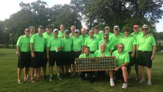 Member of Port Huron Golf Club pose with the Interclub Tournament trophy after winning it last summer.