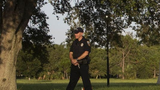 Police guard the perimeter of the Naples Commons, where two bodies were found in the afternoon of July 7. Police received a call from a witness who heard gunshots in the area.