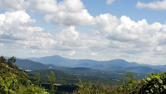 The air has gotten clearer in Western North Carolina, but climate change may cause more issues.