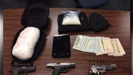 Guns, drugs and a large amount of cash were found in the home of Buddy Randall Parker.