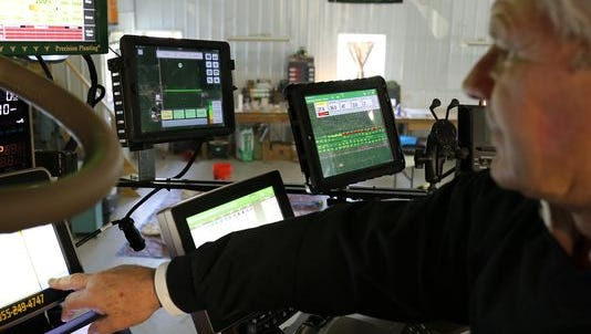 Illinois farmer Ken Dalenberg, a member of the Farmers Business Network, shows the data that he supplies and collects to help with planting and marketing decisions.