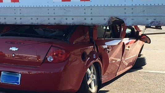 A car driven by a Portland man was wedged under a semi truck in Orange Township, Mich.