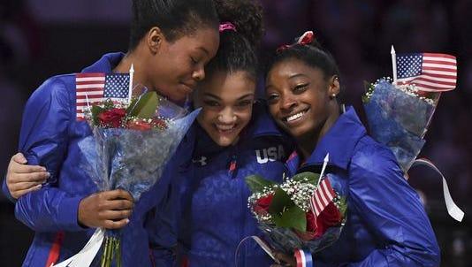 U.S. Olympic gymnasts, from left, Gabby Douglas, Laurie Hernandez and Simone Biles.