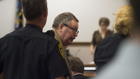 Almond Upton is led out of court during a recess in this file photo.
