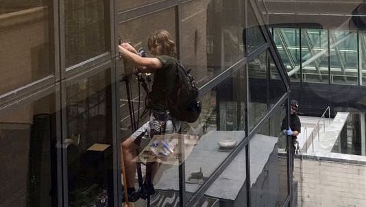Dude is climbing Trump Tower.