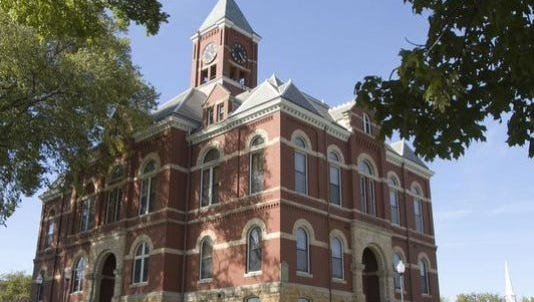 The Livingston County Board of Commissioners approved a budget reduction due to coronavirus. The historic county courthouse in Howell is home to some county departments.