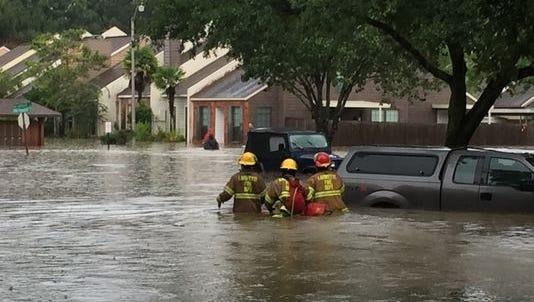 Emergency crews evacuate residents from Long Plantation Suites near River Ranch.