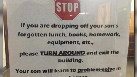 Sign on the door at Little Rock Catholic High School for Boys