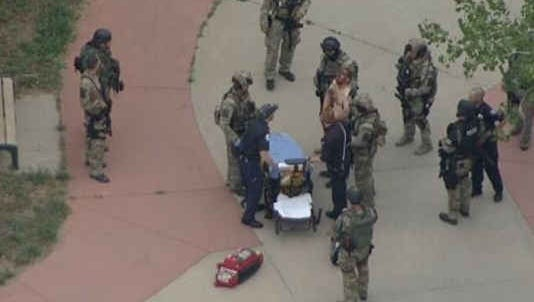 Police have taken an armed and dangerous suspect into custody following a manhunt in Boulder.