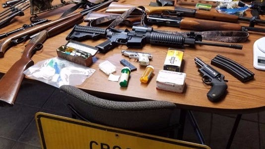 Police say they found stolen vehicles, drug and a child living among materials for meth production Friday, Aug. 26, 2016, in Van Buren County.