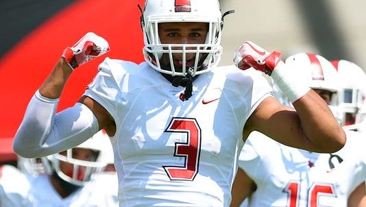 Darrien Beavers runs onto the field for Cincinnati Colerain prior to its game against Warren Central.