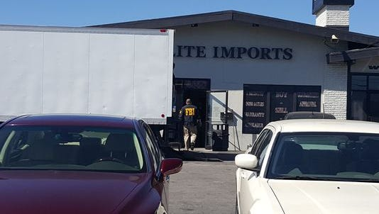 FBI agents conduct an investigation at Elite Imports in the 4500 block of North Keystone Avenue.