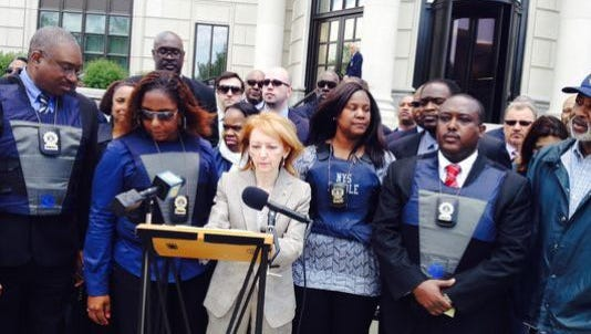 Parole officers and their lawyers announce lawsuit in front of the federal courthouse in White Plains in May 2014.
