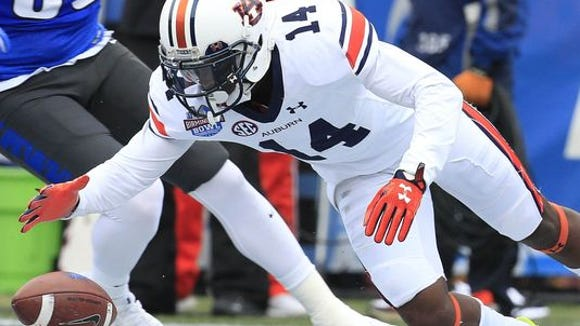 Auburn Tigers defensive back Stephen Roberts (14) falls