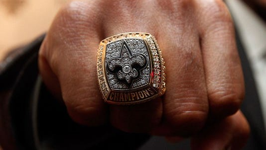 A burglar made off with a Saints Super Bowl ring from a house in the Lower Garden District.