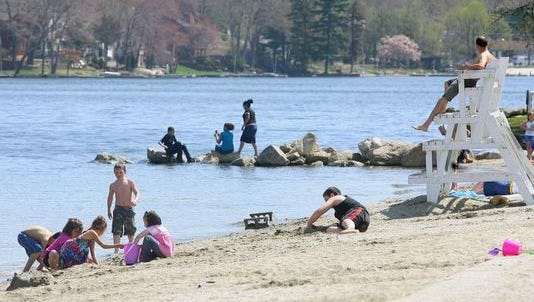 Visitors to a beach on Lake Hopatcong enjoy a beautiful day. A 2-day swim festival will be held there this weekend.