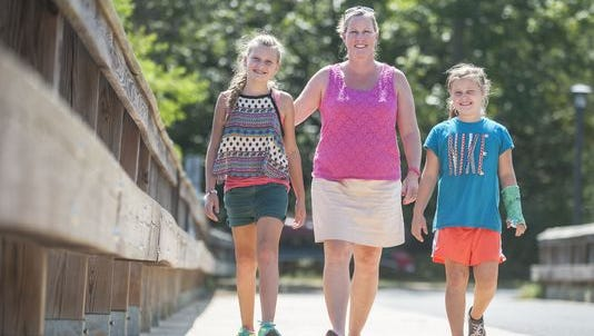 Medford Lakes resident Jen Heicklen (center) walks with her daughters Anna (left) and Ava during last year's NJ Walks for Tourette Syndrome event. This year's 5K walk/run will be held on Sept. 18 in Medford Lakes.