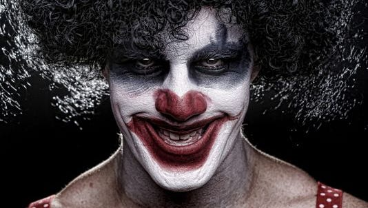 Stock image of a scary clown.
