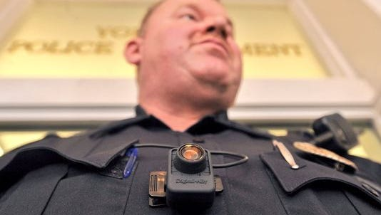A York City Police officer wears his body camera during a press conference in March. The Hanover Borough Police Department recently started using body-worn cameras.