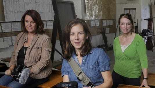 """Documentary co-directors Kelly Nathe, left, and Norah Shapiro, center, pose in 2014 in Holdingford with Elaine Davis, author of the book that inspired """"Minnesota 13: From Grain to Glass"""". Davis died last year."""