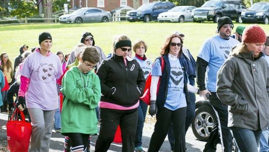 People participate in a past Sweet Walk to Remember.