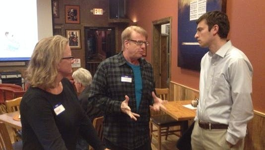 State Democratic executive director Joe Kabourek, right, chats with Lincoln County party officers Nina Grunseth and Steve Duffy earlier this year.