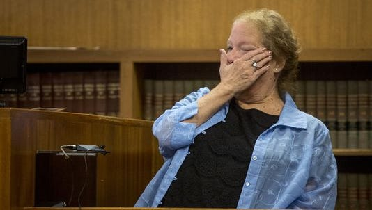 Roxanne Polidan-Jackson cries and wipes a tear as she recalls finding her deceased daughter in her basement during a preliminary examination Friday, September 23, 2016 in the courtroom of Judge Cynthia Plazter at the St. Clair County Courthouse in Port Huron.