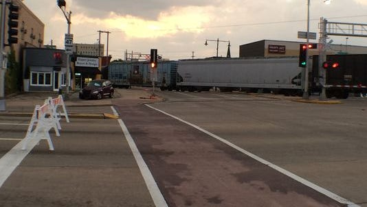 Major roads through Appleton were closed after a train stuck a man early Sunday morning.