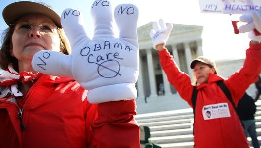 Protesters opposed to the Affordable Care Act march on the Supreme Court in 2012.