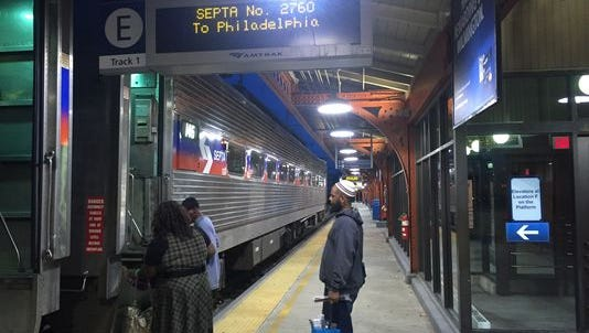 Passengers wait to board a SEPTA train in Wilmington in 2015. Service was cut in July and will return to normal Monday.
