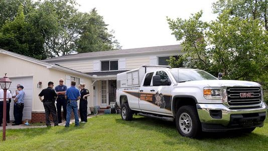 Ingham County Animal Control and other agencies removed 126 cats from this house in the Groesbeck neighborhood on June 10, 2015.