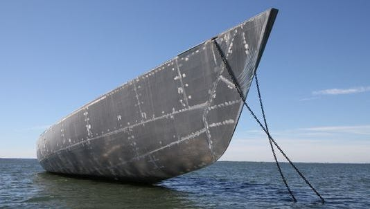 An unfinished yacht is anchored in Long Island Sound about two miles from the Mamaroneck shoreline, as seen in this photo.