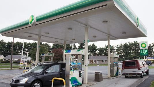 Customers fuel up at a BP gas station on Basin Road near New Castle. New Jersey lawmakers voted Friday to raise the fuel tax by 23 cents per gallon.