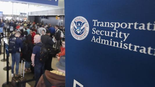 Passengers at O'Hare International Airport wait in line to be screened at a Transportation Security Administration (TSA) checkpoint on May 16, 2016.