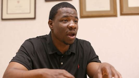 Omar Pouncy, 28, was recently released from prison where he was serving what amounts to a life sentence after being convicted of five carjackings, armed robbery and weapons charges. Pouncy, who is released on bond, now works as the chief of appeals with his lawyer Davif L. Moffitt, at his law office in Bingham Farms.