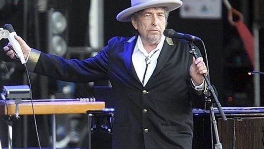 """This July 22, 2012, file photo shows U.S. singer-songwriter Bob Dylan performing onstage at """"Les Vieilles Charrues"""" Festival in Carhaix, western France. he performs at Municipal Auditorium at 8 p.m.  Tuesday., Oct. 25."""