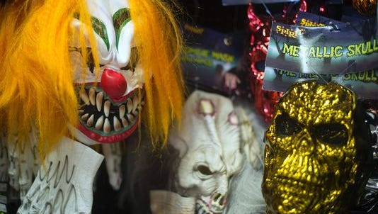 This file photo taken on October 21, 2013 shows, Halloween masks on a wall at Spirit Halloween costume store in Easton, Maryland. A series of creepy clown sightings across the United States has caused a wave of hysteria, forcing police and schools to scramble to contain spreading jitters, and even the White House to weigh in.
