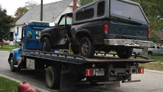 A truck involved in a fatal crash at 11th and Bancroft is removed from the scene.