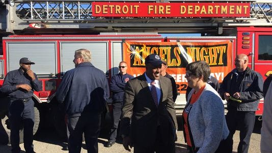 Detroit fire commissioner Eric Jones, center, and others attend an Angels' Night press conference on Oct. 10, 2016.
