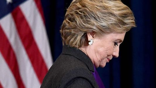 Hillary Clinton steps down a staircase after making a concession speech following her defeat to Republican President-elect Donald Trump, in New York on Nov. 9.
