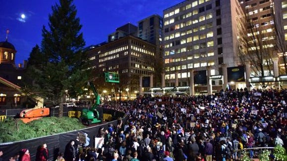 Protesters gather in Pioneer Courthouse Square in Portland, the third night of protests over the results of the 2016 U.S. presidential election, Thursday, Nov. 10, 2016.